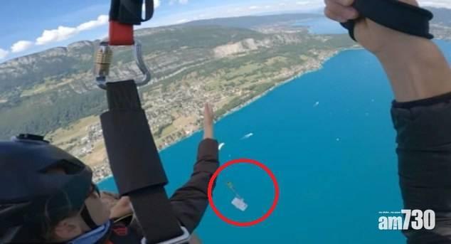 【肉痛】美遊客玩滑翔傘拍美景  失手新iPhone從5000呎跌落湖